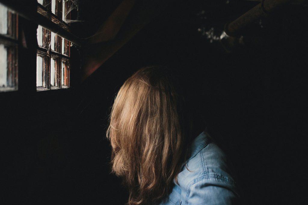 person sitting beside window