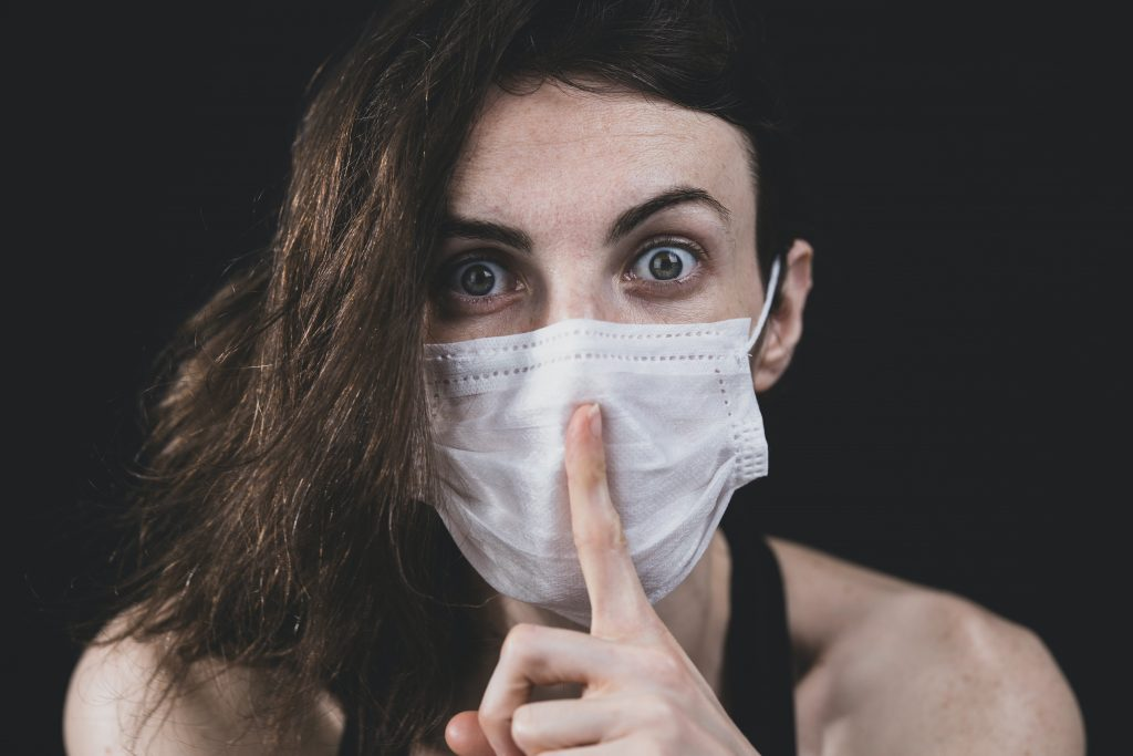 woman in black tank top with white face mask